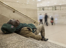 Homeless man on stairs in Grand Central Station Stock Image