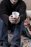 Homeless man waiting for alms. On the street Royalty Free Stock Photos