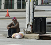 Homeless Man. Watching the May 19th Marathon Stock Photos