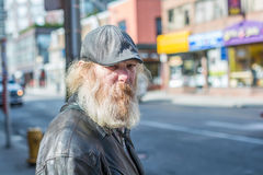 Homeless man wonder aimlessly Royalty Free Stock Images
