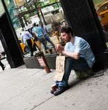 Homeless manin downtown Manhattan. New York City, Usa - July 08, 2015: Homeless manin downtown Manhattan calls for money for a ticket. According to a recent Royalty Free Stock Photography
