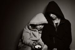 Homeless mother with her daughter. Royalty Free Stock Photo