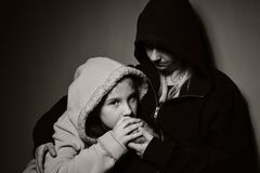Homeless mother with her daughter. Royalty Free Stock Image