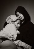 Homeless mother with her daughter. Royalty Free Stock Images