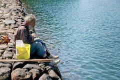 Homeless old man in Bretagne Stock Image