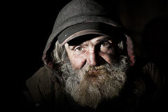 Homeless. Old homeless man on the city Royalty Free Stock Photo