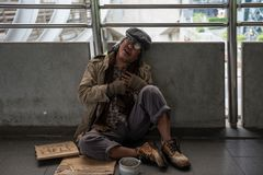 Homeless old man heart attack. Homeless old man or beggar sitting on city walk and getting painful from heart attack. Poverty and Sickness. Social issue concept Royalty Free Stock Photo