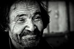 Homeless old mans smile - portrait. A smile of a homeless old man stock photography