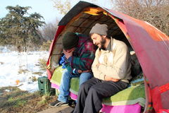 Homeless people living under the snow. Extreme conditions of survival of frost and snow, homeless, social issues Stock Image
