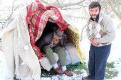 Homeless people living under the snow Stock Image