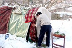Homeless people living under the snow Royalty Free Stock Photography