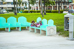 Homeless people sleep on a bench in South Beach Royalty Free Stock Photography