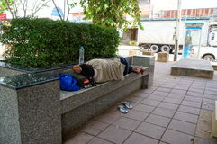 Homeless people. 6/29/2014  Homeless people sleeping in the park time daytime at Nakhon Ratchasima province in Thailand Stock Photo