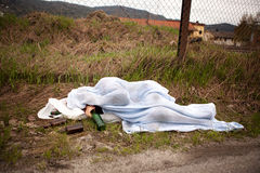 Homeless Person. A homeless drunk person sleeping in the ditch stock images