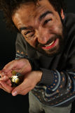 Homeless person begging for money on black Stock Image