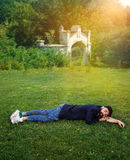 Homeless person on the lawn Royalty Free Stock Image