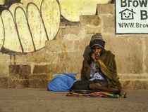A Pilgrim Feels the Cold. Is this a homeless person or a pilgrim on the ghats of Varanasi royalty free stock photography