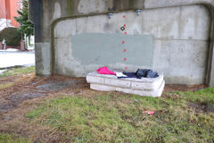 Homeless Person`s Possessions. A homeless person has set-up a discarded mattress under a bridge Royalty Free Stock Images