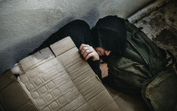 Homeless person sleeping outdoor on the road Stock Photography