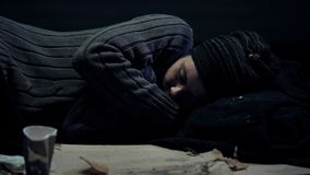Homeless person sleeping on street, shelter for poor people, city panhandling. Stock photo stock photography