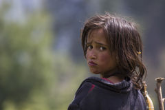 Homeless poor Girl. Poor Indian girl with staring with expressive eyes royalty free stock photo