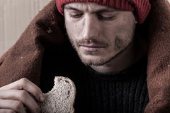 Homeless and poor man eating sandwich Royalty Free Stock Photo