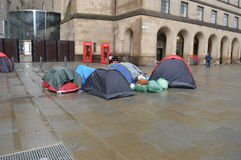 Homeless protesters camp out in St Peter's Square, manchester UK. Homeless protesters camp out in front of the Central Library in St Peter's Square, Manchester Royalty Free Stock Image
