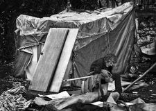 Homeless refugee in Greece. Old man,in despair, sitting outside a a self made shelter, Patras, Greece .In total it is estimated that about 100.000-150.000 royalty free stock photos