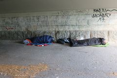 Homeless refugees sleeping in sleeping bags royalty free stock photos
