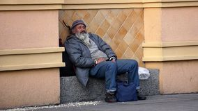 Free Homeless Resting In The Street Stock Image - 108536131