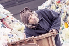 Homeless rummages in the dustbin of landfill Stock Photos