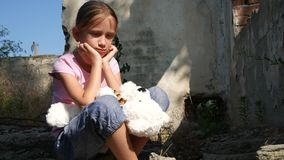 Homeless Sad Child in Abandoned Demolished House, Unhappy Stray Girl Orphan, 4K.  stock footage