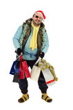 Laughing tramp in Santa hat. Holding Christmas shopping bags Royalty Free Stock Image