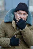 Homeless senior-aged man looks startled an alarmed. Something happening. Homeless old man seeing something that bothers him stock images