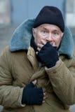 Homeless senior-aged man looks startled an alarmed Stock Images