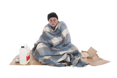 Homeless sitting on cardboard Royalty Free Stock Photos