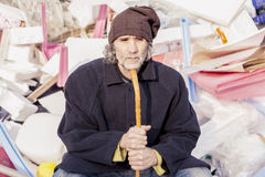 Homeless sitting in landfills in the garbage Royalty Free Stock Photo