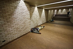 Homeless sleeping on the ground Royalty Free Stock Photo