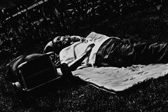 Homeless sleeping at park. 14-MAY-2014 Montreal,Canada-Homeless person sleeping at downtown park during the day.The financial crissis hit hard the middle and Royalty Free Stock Photos