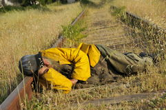 Homeless Sleeping on Tracks Stock Image