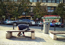 Homeless sleeps on a bench in Wenceslas Square royalty free stock image