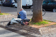 Homeless sleeps in front of Se Metropolitan Cathedral in Sao Paulo, Brazil Royalty Free Stock Photography