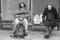 Homeless on the street. Two homeless men on the bus stop in San Francisco Royalty Free Stock Photography