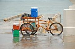 Homeless street vendor. Rusty bicycle belonging to street person stock photos
