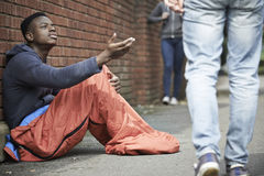Homeless Teenage Boy Begging For Money On The Street Royalty Free Stock Photos