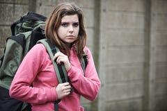 Homeless Teenage Girl On Street With Rucksack. Unhappy Homeless Teenage Girl On Streets With Rucksack Royalty Free Stock Photos