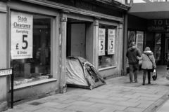 Homeless Tent in Doorway of Close Down Store royalty free stock photography