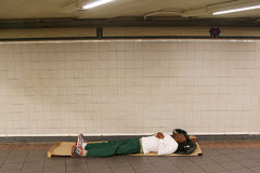 Homeless at 34th Street Subway station in Midtown Manhattan Royalty Free Stock Photos