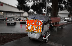 Homeless in the United States. Homeless Individual Protected from Rain by his Cart Royalty Free Stock Photos