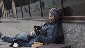 Homeless using smartphone stock video footage